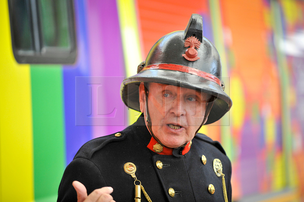 © Licensed to London News Pictures. 09/09/2017. London, UK. A staff member wears a vintage firefighter's uniform at London Fire Brigade's annual Fire Engine Festival in Lambeth. The earliest motorised fire engines still working, London Fire Brigade's brand new pump as well firefighter uniforms are on display. Photo credit : Stephen Chung/LNP