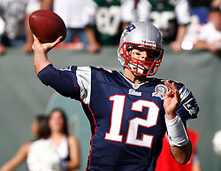 Sept 20, 2009; East Rutherford, NJ, USA; New England Patriots quarterback Tom Brady (12) throws a pass during the second half at Giants Stadium. The Jets defeated the Patriots 16-9.