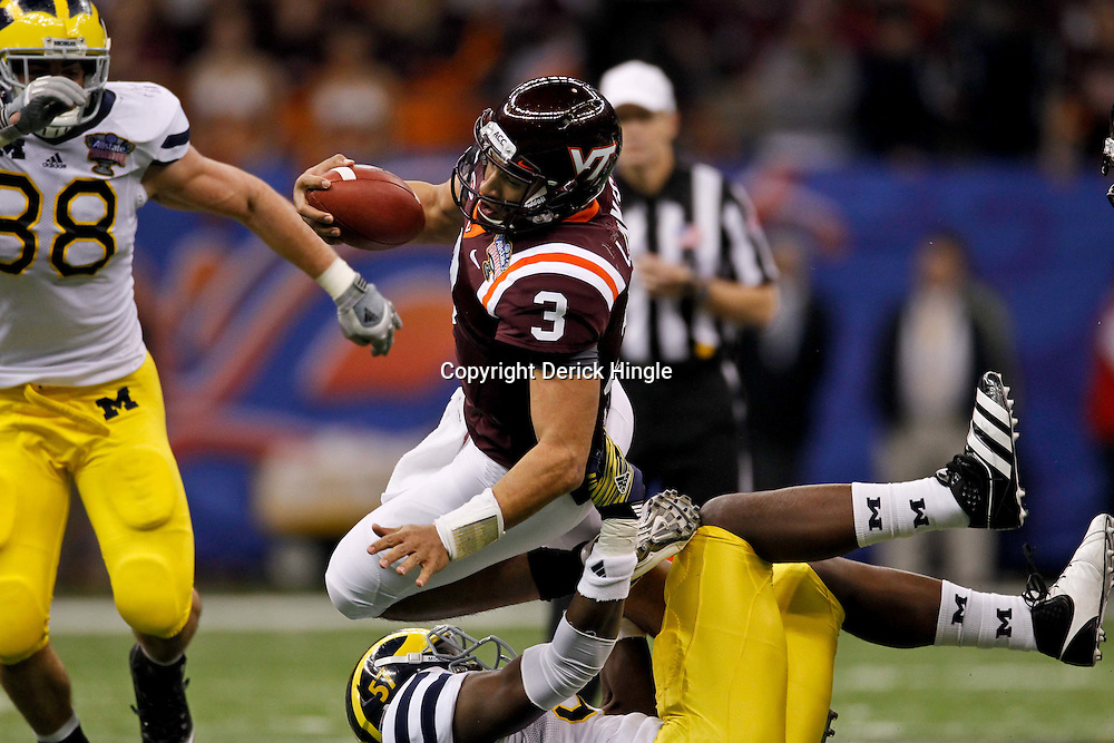 January 3, 2012; New Orleans, LA, USA; Michigan Wolverines defensive end Frank Clark (57) tackles Virginia Tech Hokies quarterback Logan Thomas (3) during the first quarter of the Sugar Bowl at the Mercedes-Benz Superdome.  Mandatory Credit: Derick E. Hingle-US PRESSWIRE
