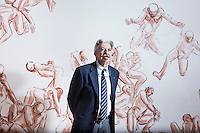 SOVERIA MANNELLI, ITALY - 17 NOVEMBER 2016: Leonardo Sirianni (64), mayor of Soveria Mannelli, poses for a portrait by a mural in the townhall council room in Soveria Mannelli, Italy, on November 17th 2016.<br /> <br /> Soveria Mannelli is a mountain-top village in the southern region of Calabria that counts 3,070 inhabitants. The town was a strategic outpost until the 1970s, when the main artery road from Naples area to Italy's south-western tip, Reggio Calabria went through the town. But once the government started building a motorway miles away, it was cut out from the fastest communications and from the most ambitious plans to develop Italy's South. Instead of despairing, residents benefited of the geographical disadvantage to keep away the mafia infiltrations, and started creating solid businesses thanks to its administrative stability, its forward-thinking mayors and a vibrant entrepreneurship numbering a national, medium-sized publishing house, a leading school furniture manufacturer and an ancient woolen mill.