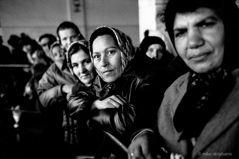 Women queue for food. Copsa Mica, Transalvania, Romania. Feb 1990