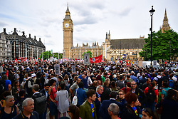 "© Licensed to London News Pictures. 27/06/2016. London, UK. ""Keep Corbyn"" Momentum demonstration outside the Houses of Parliament in london. The majority of the Labour shadow cabinet resigned today (Mon) in protest at Corbyn's leadership. Photo credit: Ben Cawthra/LNP"