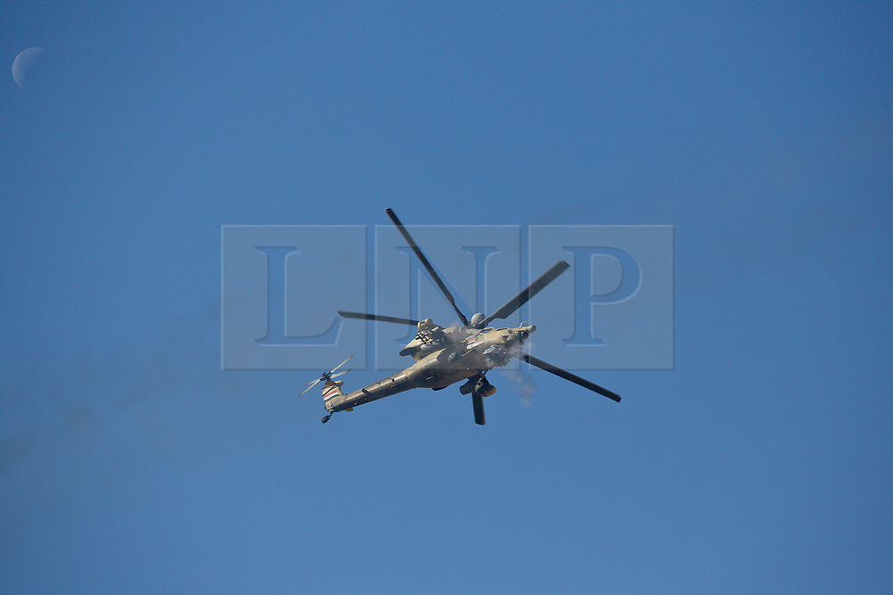 20/02/2017. Albu Saif, Iraq. An Iraqi Army Aviation Mi-28 attack helicopter fires 30mm canon rounds into the village of Albu Saif as Iraqi security forces continue with the offensive to retake western Mosul from Islamic State forces.<br /> <br /> Iraqi forces reported today that one of its attack helicopters, supporting the ongoing Mosul Offensive, was shot down by Islamic State militants.