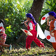 OKINAWA, JAPAN - AUGUST 17 : Young participants performs a modern Eisa folk dance in Higashi village during the Obon festival to honour the spirits of their ancestors on August 17, 2016, Okinawa prefecture, Japan.  (Photo by Richard Atrero de Guzman/NURPhoto)