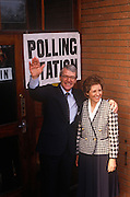 British Prime Minister, John Major and wife Norma stand outside his constituency polling station while seeking re-election after replacing Margaret Thatcher, on 9th April 1992, Huntingdon, England. Major went on to win the election and was the fourth consecutive victory for the Conservative Party although it was its last outright win until 2015 after Labour's 1997 win for Tony Blair.