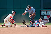 CLEVELAND, OH - AUGUST 25: Nick Swisher #33 of the Cleveland Indians reacts as he is called out by second base umpire John Hirschbeck #17 as shortstop Pedro Florimon #25 of the Minnesota Twins holds on to the ball during the seventh inning at Progressive Field on August 25, 2013 in Cleveland, Ohio. (Photo by Jason Miller/Getty Images)  *** Local Caption *** Nick Swisher; John Hirschbeck; Pedro Florimon