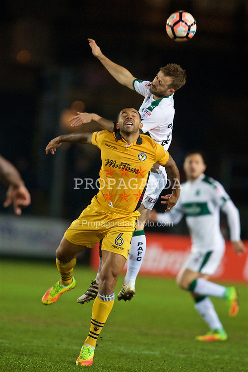 NEWPORT, WALES - Wednesday, December 21, 2016: Newport County's Joss Labadie in action against Plymouth Argyle's David Fox during the FA Cup 2nd Round Replay match at Rodney Parade. (Pic by David Rawcliffe/Propaganda)