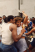 Man spreads Ice Cream on woman's underarm, Notting Hill Carnival, 1984.