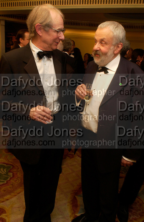 Ken Loach and Mike Leigh. 25th  annual Awards of the London critic's Circle in aid of the NSPCC. The Dorchester. Park Lane. London. 9 February 2005. ONE TIME USE ONLY - DO NOT ARCHIVE  © Copyright Photograph by Dafydd Jones 66 Stockwell Park Rd. London SW9 0DA Tel 020 7733 0108 www.dafjones.com