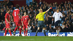 BIRMINGHAM, ENGLAND - Monday, October 13, 2008: England's Tom Huddlestone is shown the red card and sent off by referee Kevin Blom during the UEFA European Under-21 Championship Play-Off 2nd Leg match against Wales at Villa Park. (Photo by Gareth Davies/Propaganda)