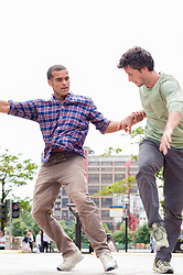 (c)Licensed to London News Pictures. 26/06/2014. London. England. Supportive, competitive, strong.. what does it mean to be a man? Following the success of dance duet Push of Dancing City in 2012, the Manchester based Company Chameleon returns with Hands Down, a ground-breaking dance exploration of how men interact. Using acrobatic and physical action, the hierarchy and boundaries of masculinity are charted, through highly physical yet sensitive contemporary dance which strips back the layers to reveal the dynamics of behaviour. Co-commissioned by Greenwich+Docklands International Festival and Dance Manchester. Photo credit Carole Edrich/LNP