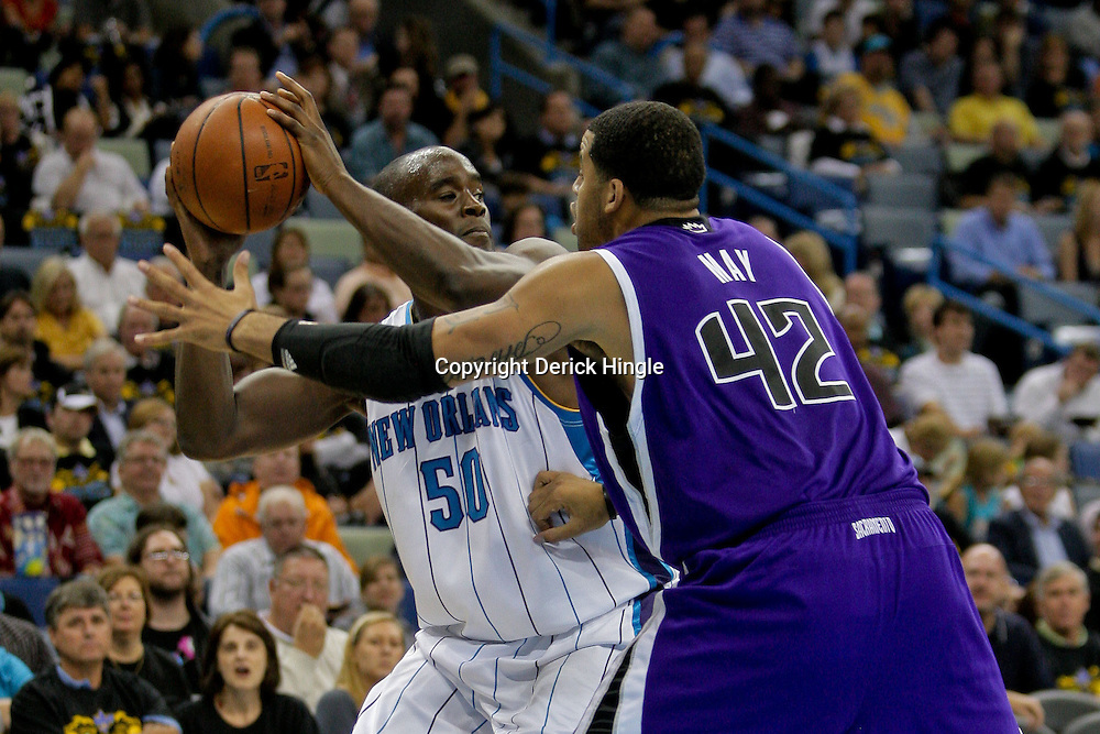 Oct 30, 2009; New Orleans, LA, USA;  New Orleans Hornets center Emeka Okafor (50) is guarded by Sacramento Kings forward Sean May (42) during the second half at the New Orleans Arena. The Hornets defeated the Kings 97-92. Mandatory Credit: Derick E. Hingle-US PRESSWIRE