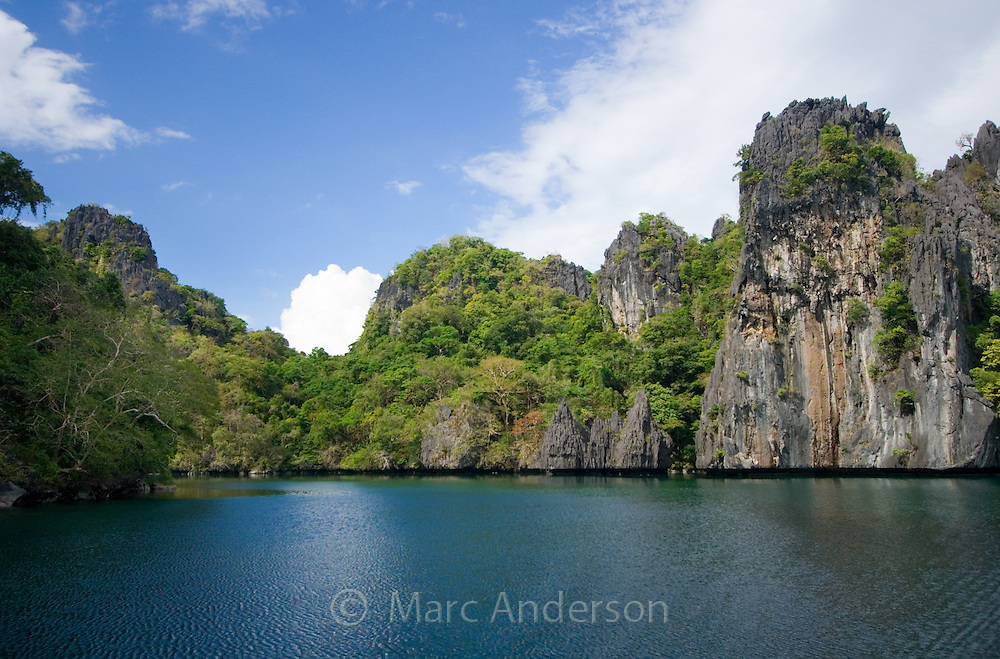 Big Lagoon surrounded by limestone cliffs in the Bacuit Archipelago , El Nido, Palawan, Philippines.