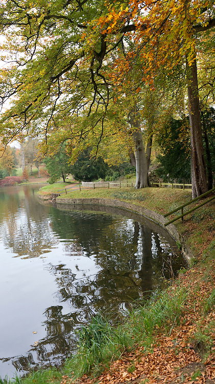 Culvert on the north end of the lake below The Hermitage at Bowood House showing the convergence of the water flow. Capability Brown designed landscape and lake in autumn at Bowood House, Wiltshire, England
