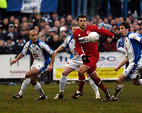Photo: Leigh Quinnell.<br /> Nuneaton Borough v Middlesbrough. The FA Cup.<br /> 07/01/2006. Middlesbroughs Mark Viduka is surrounded by Nuneaton players.