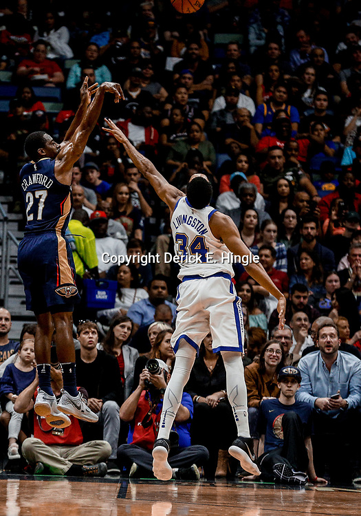 Oct 20, 2017; New Orleans, LA, USA; New Orleans Pelicans guard Jordan Crawford (27) shoots over Golden State Warriors guard Shaun Livingston (34) during the second quarter of a game at the Smoothie King Center. Mandatory Credit: Derick E. Hingle-USA TODAY Sports