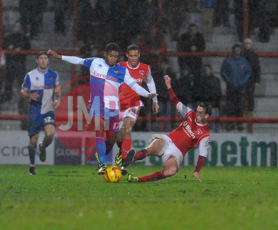 Bristol Rovers' Ellis Harrison is challenged - Photo mandatory by-line: Dougie Allward/JMP - Tel: Mobile: 07966 386802 14/12/2013 - SPORT - Football - Morecombe - Globe Arena - Morecombe v Bristol Rovers - Sky Bet League Two