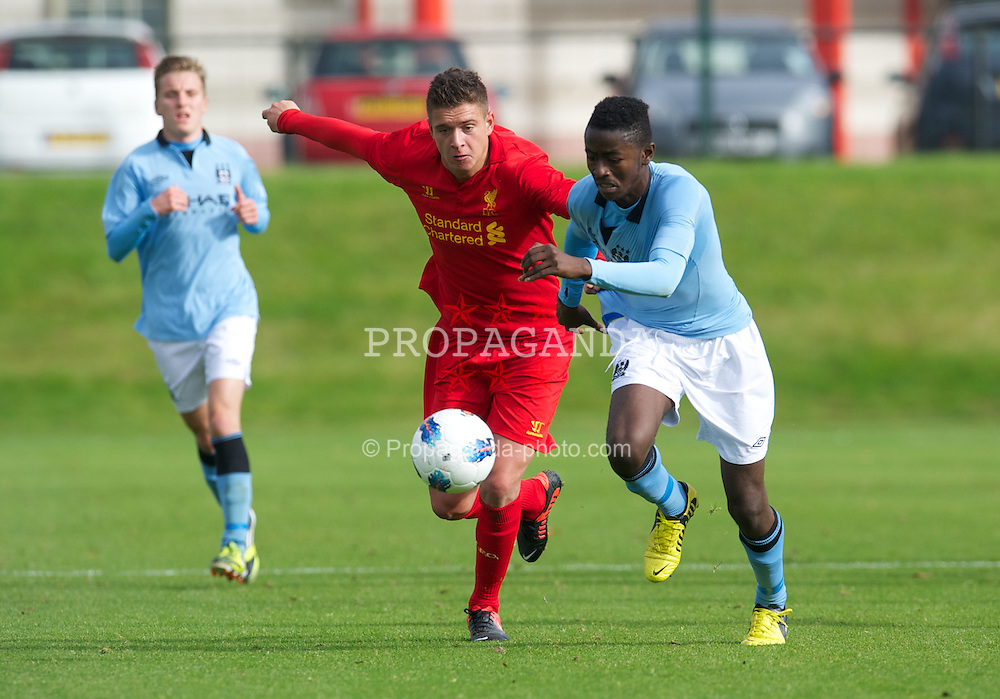 KIRKBY, ENGLAND - Saturday, October 20, 2012: Liverpool's Kristoffer Peterson in action against Manchester City's Elan Assaini during the Premier League Academy match at the Kirkby Academy. (Pic by David Rawcliffe/Propaganda)