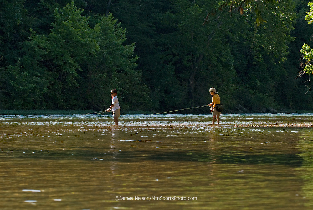 Seven- and nine-year-old brothers fly fish for bluegill on the James River, Missouri