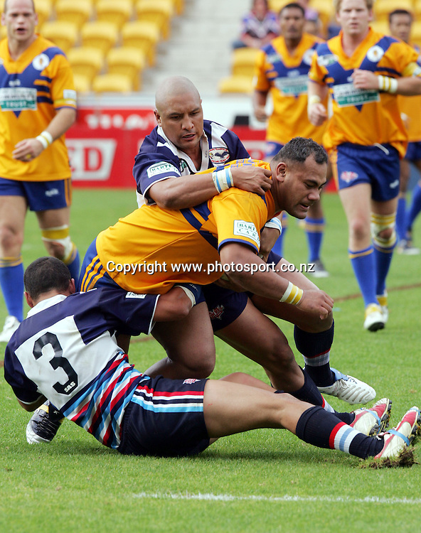 Paulo Teniseli of Mt Albert is taken to the ground during the Barter Card Cup Rugby League game between Mt Albert and Otahuhu/Ellerslie at Ericsson Stadium, Auckland on Sunday 1 May, 2005. Photo: Andrew Cornaga/PHOTOSPORT<br />