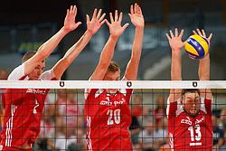 21-09-2019 NED: EC Volleyball 2019 Poland - Spain, Apeldoorn<br /> 1/8 final EC Volleyball / Maciej Muzaj #2 of Poland, Mateusz Bieniek #20 of Poland, Michał Kubiak #13 of Poland