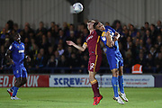 AFC Wimbledon defender Rod McDonald (26) battles for possession with Bradford City attacker George Miller (12) during the EFL Sky Bet League 1 match between AFC Wimbledon and Bradford City at the Cherry Red Records Stadium, Kingston, England on 2 October 2018.