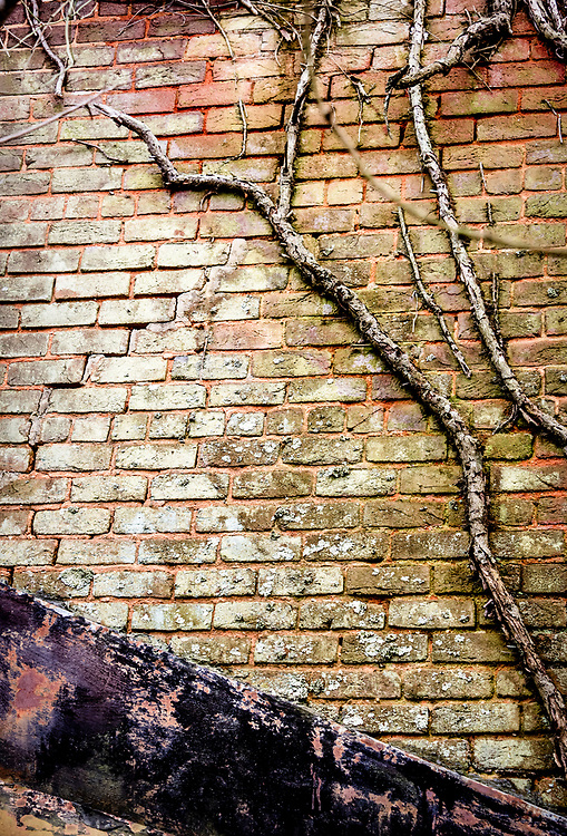 Rich textures, shapes and colors in the decaying brickwork and flashing make for an interesting composition.  The image was processed to emulate Kodachrome film.