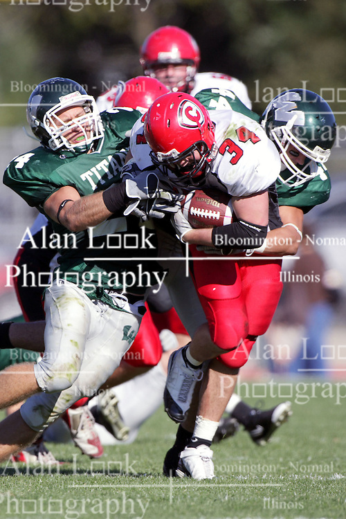 04 October 2008: Jake Smith breaks through the line and into the secondary while Nick Nikolich works to slow his run in a battle between the Carthage Red Men and the Illinois Wesleyan University Titans, Game action was at Wilder Field on the campus of Illinois Wesleyan University in Bloomington Illinois.