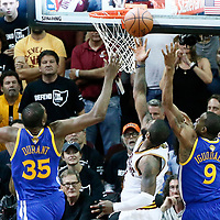 09 June 2017: Cleveland Cavaliers guard Kyrie Irving (2) goes for the layup between past Golden State Warriors forward Kevin Durant (35) and Golden State Warriors forward Andre Iguodala (9) during the Cleveland Cavaliers 137-11 victory over the Golden State Warriors, in game 4 of the 2017 NBA Finals, at  the Quicken Loans Arena, Cleveland, Ohio, USA.