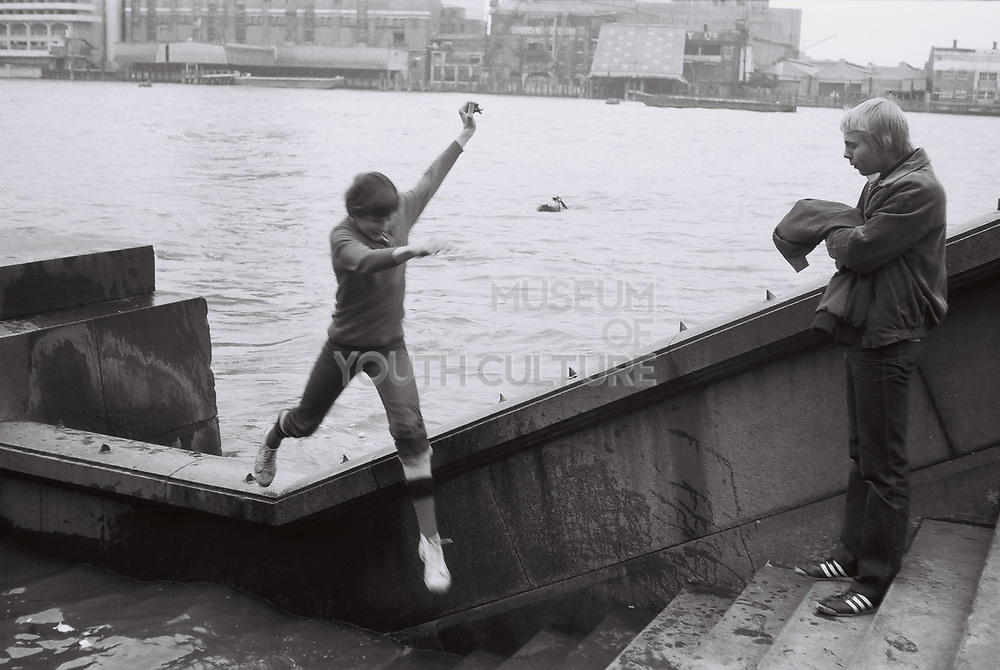 Two teenage friends by the thames. London Thames, UK, 1980s.
