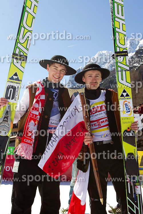 Winner Kamil Stoch and third placed  Adam Malysz of Poland celebrate after the Flying Hill Individual at 4th day of FIS Ski Jumping World Cup Finals Planica 2011, on March 20, 2011, Planica, Slovenia. (Photo by Vid Ponikvar / Sportida)