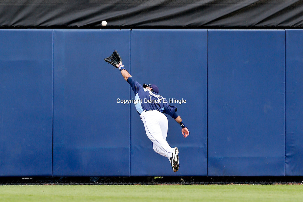 Mar 2, 2013; Port Charlotte, FL, USA; Tampa Bay Rays second baseman Sean Rodriguez (1) dives for a ball hit by Baltimore Orioles third baseman Manny Machado (not pictured) who ended up with a triple on the play during the top of the sixth inning of a spring training game at Charlotte Sports Park. Mandatory Credit: Derick E. Hingle-USA TODAY Sports