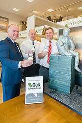 Oak Furniture Land Rotherham Store Manager Jez Groom, Cake Artist Rose Dummer Rotherham Hospice Fundraising Team Leader Anne Giblin and Events Fundraiser Ash Corker enjoy a Celebration Breakfast with Man of Steel at the opening of the Oak Furniture Land Rotherham Store. The cake will be donated to Rotherham Hospice who will use it to help raise funds<br /> <br /> 3 June 2015<br />  Image &copy; Paul David Drabble <br />  www.pauldaviddrabble.co.uk