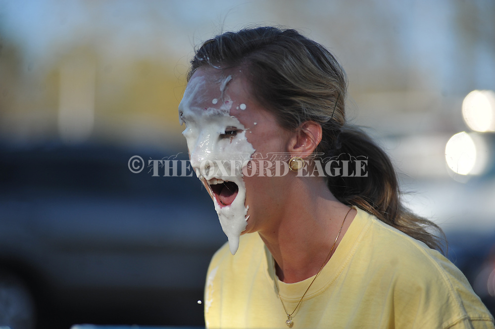 University of Mississippi Pi Beta Phi sorority member takes a pie to the face during a sorority fundraiser, in Oxford, Miss. on Wednesday, April 9, 2014. (AP Photo/Oxford Eagle, Bruce Newman)