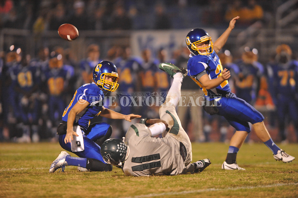 Vicksburg's Terrell Smith (11) blocks a field goal attempt by Oxford High's Cody Mills (29), out of the hold of Oxford High's Harrison Hopper (3), in MHSAA Class 5A playoff action in Oxford, Miss. on Friday, November 15, 2013. Oxford won 50-7.