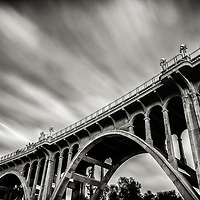 """Long Exposure photograph of the Colorado Street Bridge. The historical structure and famous landmark is known as """"Suicide Bridge"""" to locals because of its dark history. It spans the Arroyo Seco in Pasadena, CA."""