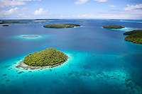 Vavau group, Tonga from above highlights the many hues of blue contrasted with green palms of limestone islands