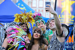 © Licensed to London News Pictures. 30/12/2019. London, UK. Performers from London School of Samba take a selfie at the preview of the London New Year's Day Parade in Covent Garden Piazza.<br /> The London New Years Day Parade, in its 32nd year will take place on 1 January 2020 and will feature more than 10,000 performers from across the world. Photo credit: Dinendra Haria/LNP