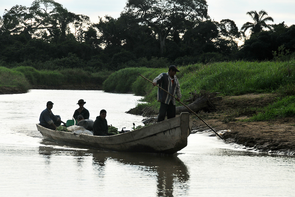 Chimani men arriving by boat near San Lorenzo de Moxos, Beni, Bolivia