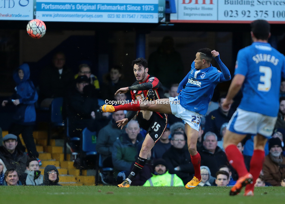 30.01.2016. Fratton Park, Portsmouth, England. Emirates FA Cup 4th Round. Portsmouth versus AFC Bournemouth.  Bournemouth Defender Adam Smith crosses into the Portsmouth area, as Portsmouth Midfielder Kyle Bennett attempts a block
