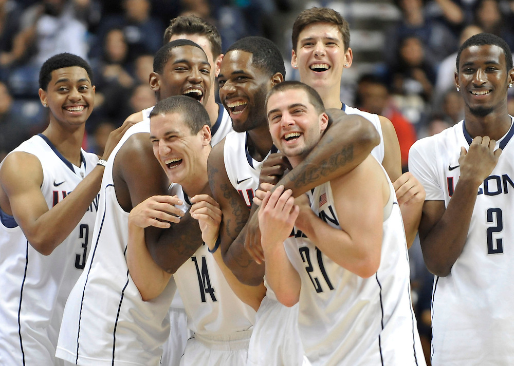 Members of the Connecticut men's team react during the First Night NCAA college basketball exhibition in Storrs, Conn., Friday, Oct. 14, 2011.  (AP Photo/Jessica Hill)