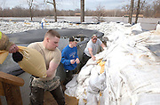 From left, Colby Bond, Scott Heide and Jim Davis shore up the sandbag levee in Bob Turner's back yard on Convair in Arnold. The Meramec River completely flooded Arnold City Park and threatened a number of homes in Arnold. Bond, on home for leave from the U.S. Army, and Heide came from Franklin County to pitch in while Davis lives in the neighborhood. Volunteers worked through the night Friday and Saturday in an effort to hold back the floodwaters from Arnold homes.