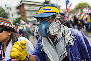 "01 DECEMBER 2013 - BANGKOK, THAILAND: An anti-government protestor with his ""gas mask"" and ""goggles."" Thousands of anti-government Thais confronted riot police at Phanitchayakan Intersection, where Rama V and Phitsanoluk Roads intersect, next to Government House (the office of the Prime Minister). Protestors threw rocks, cherry bombs, small explosives and Molotov cocktails at police who responded with waves of tear gas and chemical dispersal weapons. At least four people were killed at a university in suburban Bangkok when gangs of pro-government and anti-government demonstrators clashed. This is the most serious political violence in Thailand since 2010.    PHOTO BY JACK KURTZ"