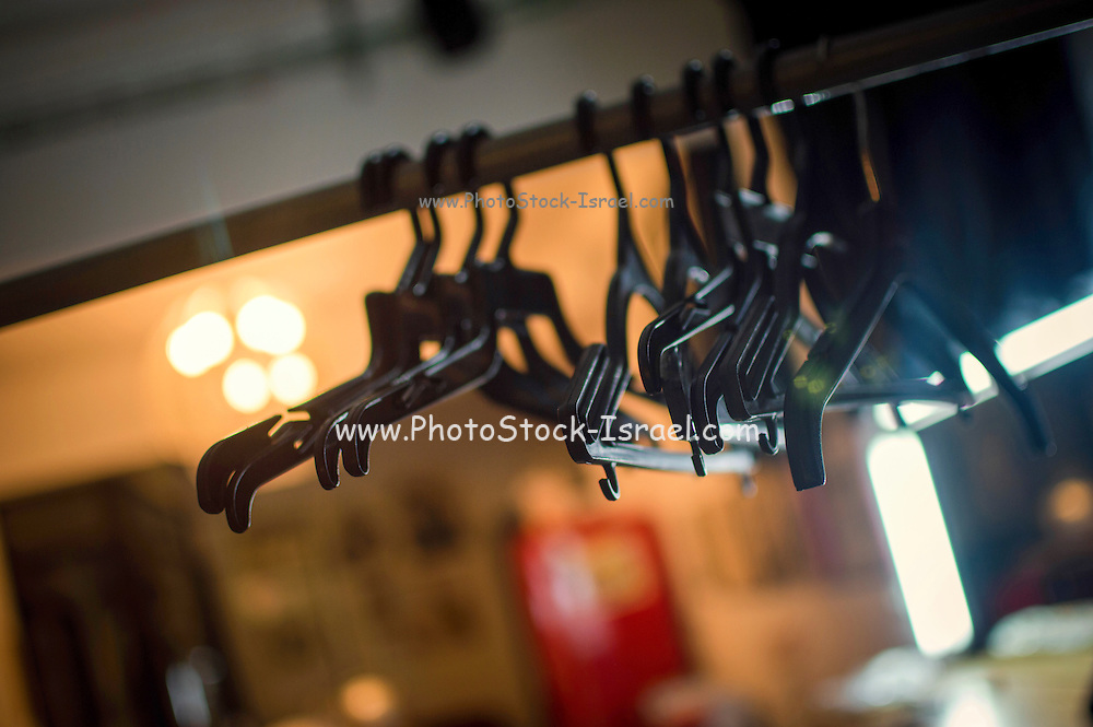 Empty clothes hangers on a rack