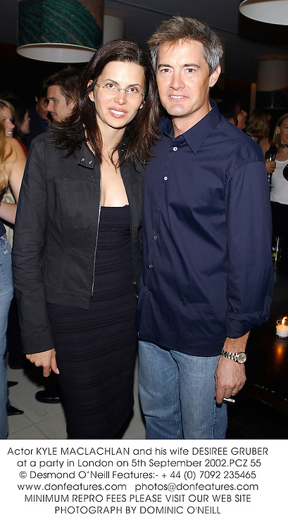 Actor KYLE MACLACHLAN and his wife DESIREE GRUBER at a party in London on 5th September 2002.	PCZ 55
