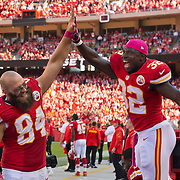 Kansas City Chiefs tight end Sean McGrath (84) high-rived Kansas City Chiefs running back Cyrus Gray (32) in the final minute of the Chiefs' 24-7 win over the Oakland Raiders in NFL action on October 13, 2013 at Arrowhead Stadium in Kansas City, Mo.