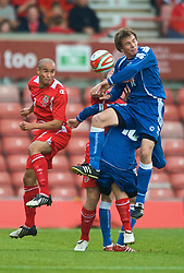 WREXHAM, WALES - Saturday, October 10, 2009: Wales' Ashley Richards and Bosnia-Herzegovina's Josip Coric during the UEFA Under-21 Championship Qualifying Round Group 3 match at the Racecourse Ground. (Pic by Chris Brunskill/Propaganda)