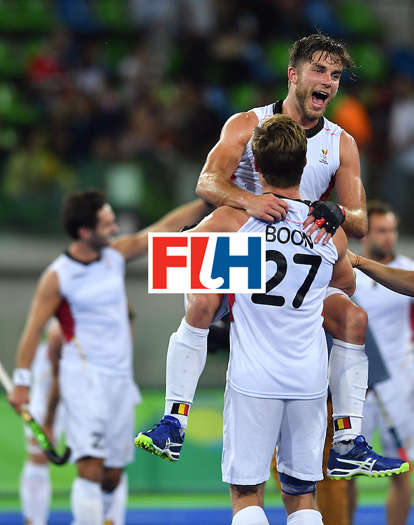 Belgium's Tom Boon (bottom) and Belgium's Cedric Charlier celebrate winning the men's semifinal field hockey Belgium vs Netherlands match of the Rio 2016 Olympics Games at the Olympic Hockey Centre in Rio de Janeiro on August 16, 2016.  / AFP / Carl DE SOUZA        (Photo credit should read CARL DE SOUZA/AFP/Getty Images)