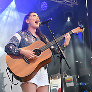 Basking in London - Maddie Bowe performs at the Feast of St George to celebrate English culture with music and English food stalls in Trafalgar Square on 20 April 2019, London, UK.