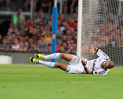 Karim Benzema is injured  during the Supercopa 1st leg match at the Nou Camp, Barcelona, Spain between FC Barcelona and Real Madrid on 23rd August 2012.